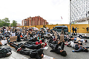 People hold placards and take a knee in front of the US Embassy in South London, Sunday, Jun 7, 2020, during a rally to protest against the killing of George Floyd by police officers in Minneapolis, USA. Floyd, a black man, died after he was restrained by Minneapolis police while in custody on May 25 in Minnesota. (Photo/ Vudi Xhymshiti)