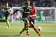 Marc Muniesa of Stoke city and Cardiff city's Kevin Theophile-Catherine (r) tussle for the ball. Barclays Premier league match, Cardiff city  v Stoke city at the Cardiff city stadium in Cardiff, South Wales on Saturday 19th April 2014. pic by Mark Hawkins, Andrew Orchard sports photography,
