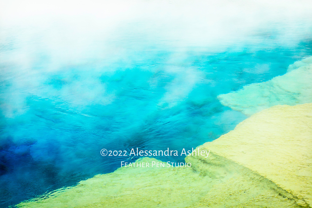 Abstract shapes and colors of steaming geothermal pool, Yellowstone National Park, Wyoming.