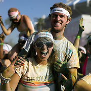 """Participants of the Color Run Orlando event react to getting covered by the colored dust after completing the 5K.  Billed as the """"Happiest 5K on the Planet,? the Color Run is a family-friendly run for those who don't mind getting dust thrown at them after beginning the race with a plain white t-shirt on. This is the first event of the season and occured at the Citrus Bowl in downtown Orlando, Florida on January 13, 2013. (AP Photo/Alex Menendez)"""