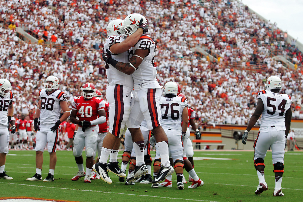 Sept 8, 2012; Blacksburg, VA, USA; Virginia Tech Hokies fullback Riley Beiro (32) and running back Michael Holmes (20) celebrate a touchdown by Holmes in first half against the Austin Peay Governors at Lane Stadium. Mandatory Credit: Peter Casey-USA TODAY Sports