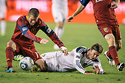 Los Angeles Galaxy midfielder David Beckham, right, is fouled by Real Salt Lake midfielder Javier Morales during the second half of the Western Conference Championship soccer match, Sunday, Nov. 6, 2011, in Carson, Calif. The Galaxy won 3-1. (AP Photo/Bret Hartman)