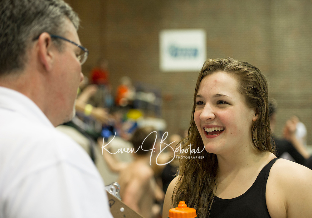 Coach Quinn congratulates Concord's Alaina Pribis after her win in the 200 yard Freestyle at the NHIAA Division I Championships at UNH Sunday afternoon.  (Karen Bobotas/for the Concord Monitor)