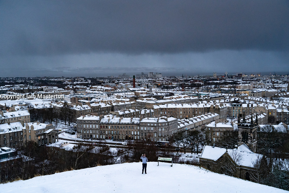 Edinburgh, Scotland, UK. 9 Feb 2021. Big freeze continues in the UK with Storm Darcy bringing several inches of snow to Edinburgh overnight. Pic; snow covered rooftops in Leith viewed from Calton Hill. Iain Masterton/Alamy Live news