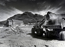 Bulldozers and lorries continue clearing operations in District Six as St Mark's Church stands forlornly in the background. The government plans to build a multi-million rand technikon for whites on the site, but the Anglican church, which owns the building, refuses to budge.