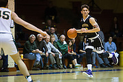 San Francisco State guard Coley Apsay (10) pushes the ball down the court against the San Francisco Dons at Kezar Pavilion in San Francisco, Calif., on December 6, 2016. (Stan Olszewski/Special to S.F. Examiner)