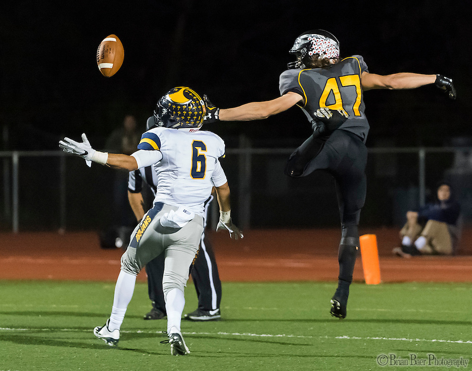 Oak Ridge Trojans Jakob Flores (6), breaks a fourth down pass intended for Del Oro Golden Eagle's Dawson Hurst (47), during the fourth quarter as the Del Oro Golden Eagles varsity football team host the Oak Ridge Trojans, Friday Oct 21, 2016.<br /> photo by Brian Baer