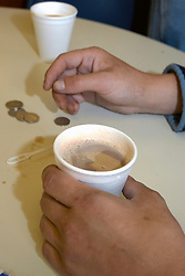 Homeless man drinking coffee at St Anne's drop in centre for homeless people; Leeds UK