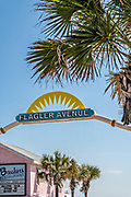 Car entrance to Flagler Avenue beach and boardwalk in New Smyrna Beach, Florida. New Smyrna allows private vehicles to drive on the sand and park along the beach.
