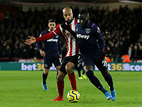 Sheffield United's David McGoldrick battles with West Ham United's Arthur Masuaku<br /> <br /> Photographer Rich Linley/CameraSport<br /> <br /> The Premier League - Sheffield United v West Ham United - Friday 10th January 2020 - Bramall Lane - Sheffield <br /> <br /> World Copyright © 2020 CameraSport. All rights reserved. 43 Linden Ave. Countesthorpe. Leicester. England. LE8 5PG - Tel: +44 (0) 116 277 4147 - admin@camerasport.com - www.camerasport.com