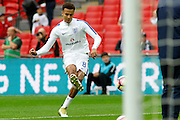 England Midfielder Dele Alli warms up before kick off during the FIFA World Cup Qualifier match between England and Malta at Wembley Stadium, London, England on 8 October 2016. Photo by Andy Walter.
