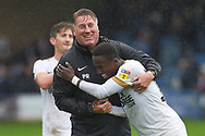 Peterborough United midfield Siriki Dembele  (10) and  Peterborough United assistant manager Paul Raynor  smiling after  the EFL Sky Bet League 1 match between Gillingham and Peterborough United at the MEMS Priestfield Stadium, Gillingham, England on 22 September 2018. Picture by Martin Cole