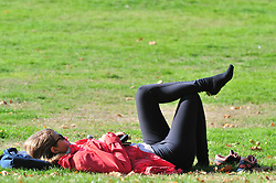 © Licensed to London News Pictures. 10/10/2018<br /> GREENWICH, UK.<br /> Young lady chilling with her shoes off.<br /> An autumnal Greenwich Park,Greenwich on a sunny October day in London, temperatures at around 22C.<br /> Photo credit: Grant Falvey/LNP