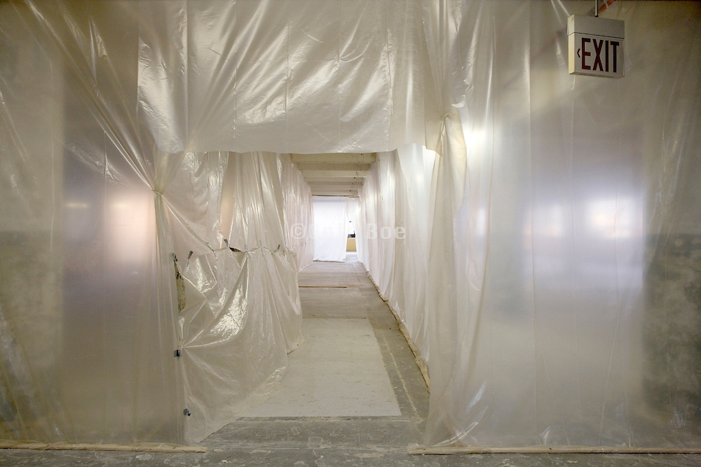 a hall and walls created out of plastic in a building which is being renovated