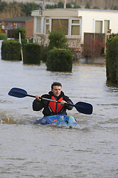 © Licensed to London News Pictures. 03/01/2014<br /> Little Venice resident Mark Smith Canoeing out of the country park site. He has a boat on the site.<br /> The Medway River in Yalding has burst its banks again flooding Large parts of Yalding including Little Venice Country Park and The Lees.<br /> Flood waters are back again in Kent as Gales and heavy rain hit the UK over night.<br /> Photo credit :Grant Falvey/LNP
