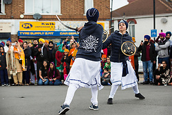 Slough, UK. 28th April 2019. Sikhs demonstrate martial arts skills during the Vaisakhi Nagar Kirtan procession. Vaisakhi is the holiest day in the Sikh calendar, a harvest festival marking the creation of the community of initiated Sikhs known as the Khalsa.