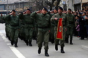 People waving the Albanian national flag are gathered outside the government building in the capital Pristina, to celebrate the tenth anniversary of the Kosovo Liberation Army and its known Legendary Commander, Adem Jashari. A parade was also organised by the Kosovo Protection Corps (KPC in picture) at the presence of Kosovo Prime Minister Hashim Thaçi, President Fatmir Sejdiu, Assembly speaker Jakup Krasniqi and other political and cultural representatives. (Photo by Vudi Xhymshiti)