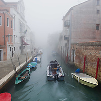 VENICE, ITALY - NOVEMBER 19: A motor boat sails in one of the canal as thick fog shrouds the city, on November 19, 2011 in Venice, Italy. Venice woke up this morning under a heavy blanket of fog adding to the atmoshere of the city. HOW TO LICENCE THIS PICTURE: please contact us via e-mail at sales@xianpix.com or call our offices London   +44 (0)207 1939846 for prices and terms of copyright. First Use Only ,Editorial Use Only, All repros payable, No Archiving.© MARCO SECCHI