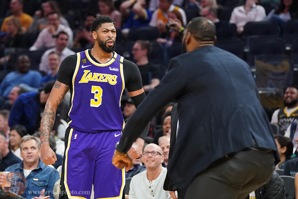 February 27, 2020; San Francisco, California, USA; Los Angeles Lakers forward Anthony Davis (3) celebrates with forward LeBron James (23) against the Golden State Warriors during the third quarter at Chase Center.