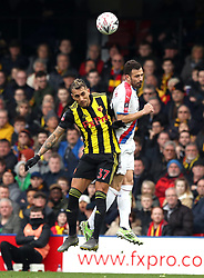 Watford's Roberto Pereyra (left) and Crystal Palace's Luka Milivojevic battle for the ball during the FA Cup quarter final match at Vicarage Road, Watford.
