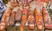 Artistic Asian wood face sculpture for sale at concession stand. Dragon Festival Lake Phalen Park St Paul Minnesota USA
