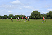 Men playing football in Regent's Park, one of London's Royal Parks
