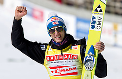 Winner in overall ski flying classification Gregor Schlierenzauer of Austria celebrates at flower ceremony after the Flying Hill Individual at 4th day of FIS Ski Jumping World Cup Finals Planica 2011, on March 20, 2011, Planica, Slovenia. (Photo by Vid Ponikvar / Sportida)