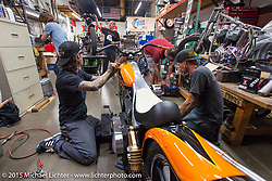 Scott Jones working on final prep on his bike with Steven Blalock at Noise Cycles the night before Born Free 6. Santa Ana, CA. USA. June 26, 2014.  Photography ©2014 Michael Lichter.