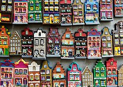 Miniature refrigerator magnet souvenirs in shape of traditional Dutch houses in Amsterdam