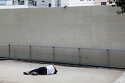 Man lied on the ground on Tokyo streets.