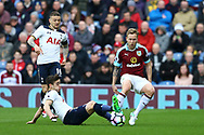 Harry Winks of Tottenham Hotspur looks to tackle Scott Arfield of Burnley (r). Premier League match, Burnley v Tottenham Hotspur at Turf Moor in Burnley , Lancs on Saturday 1st April 2017.<br /> pic by Chris Stading, Andrew Orchard sports photography.