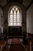 Geometric pattern design 19th century stained glass east window parish church of Saint Mary, Battisford , Suffolk, England