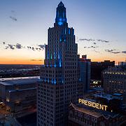 Power and Light Building in teal lighting scheme for Myasthenia Gravis Awareness Month. Kansas City, Missouri, June 2020.