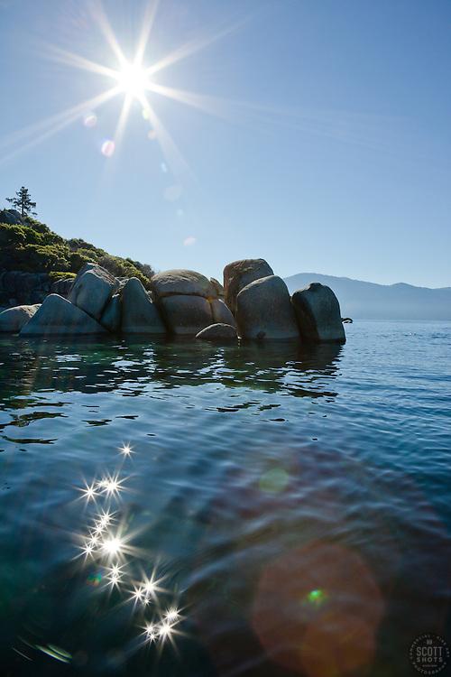 """Boulders on Lake Tahoe 25"" - These boulders and sunburst were photographed near Speedboat Beach, Lake Tahoe."