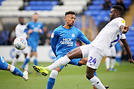 Peterborough Utd defender Tyler Denton (23) and Coventry City forward Bright Enobakhare (24) during the EFL Sky Bet League 1 match between Peterborough United and Coventry City at London Road, Peterborough, England on 16 March 2019.