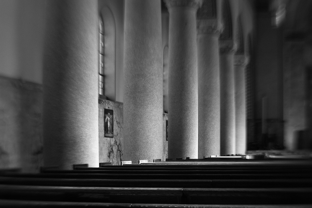 Divine light in a chapel, black and white.