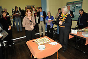 The Hon. Donna Faragher MLC pondering how to best cut the celebratory cake.