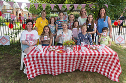 © Licensed to London News Pictures. 23/06/2018. Maidenhead, UK. British Prime Minister THERESA MAY has tea and cake with parents and children at the Cookham Dean Primary school fete as part of the Great Get Together Weekend. The national event was inspired by murdered  MP Jo Cox's belief that we've 'more in common'. The Prime Minister said the weekend was a 'fitting legacy for a much-loved and much-missed MP'. Photo credit: Ray Tang/LNP