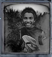 Portrait of a Filipino teenage boy with a bright smile. Palawan island, Philippines, Asia.