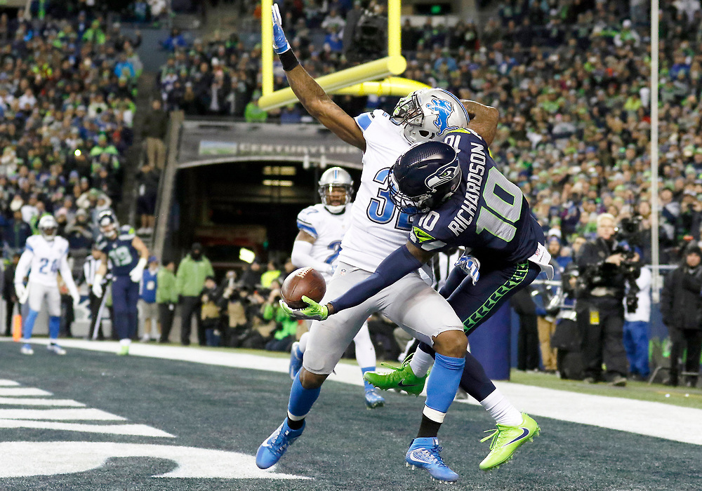 Seattle Seahawks wide receiver Paul Richardson (10) makes a one-handed touchdown catch in front of Detroit Lions strong safety Tavon Wilson (32) during an NFL football NFC wild card playoff game, Saturday, Jan. 7, 2017, in Seattle. The Seahawks defeated the Lions 26-6. (Ryan Kang/NFL)