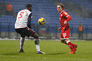 Crawley Town's Sam Matthews flicks the ball past Bolton Wanderers Ricardo Santos(5) during the EFL Sky Bet League 2 match between Bolton Wanderers and Crawley Town at the University of  Bolton Stadium, Bolton, England on 2 January 2021.