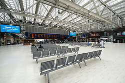 Glasgow, Scotland, UK. 1 April, 2020. Effects of Coronavirus lockdown on streets of Glasgow, Scotland. Concourse of Central Station is very quiet.