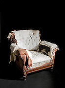 andy spain architectural photography<br /> antique chair shot in studio shabby chic tatty torn ripped black background
