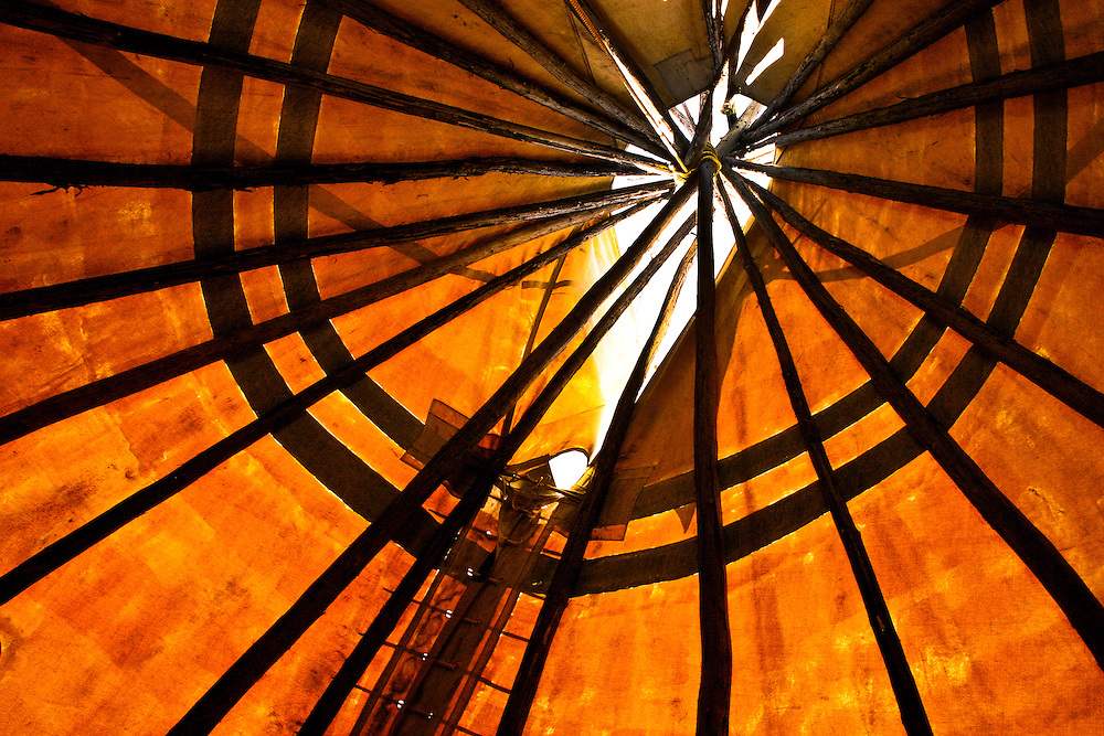 Interior of tipi, showing poles and smoke hole