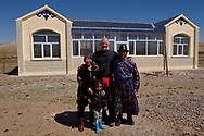 Photographer Staffan Widstrand with Mongolian Shepherd Bai Shuang Xi, his wife Li Wu Yue and their grandson in front, Inner Mongolia, China.