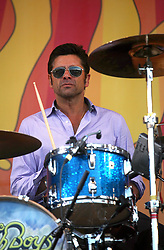 27 April 2012. New Orleans, Louisiana,  USA. .New Orleans Jazz and Heritage Festival. .The Beach Boys take to the stage to kick off their 50th anniversary tour. Television actor John Stamos joins the band on drums..Photo; Charlie Varley.