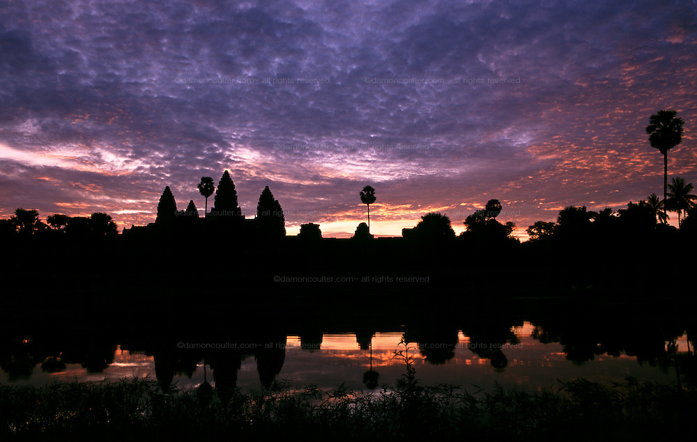 Sunrise over Angkor Wat temple in the Angkor Archeological Park in Siem Riep. Cambodia. August 2002