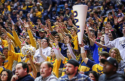 Dec 14, 2019; Morgantown, WV, USA; West Virginia Mountaineers students pause during a foul shot during the second half against the Nicholls State Colonels at WVU Coliseum. Mandatory Credit: Ben Queen-USA TODAY Sports