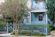 Traditional grand mansion house with wrought iron railings in the Garden District of New Orleans, Louisiana, USA