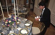 THE WHITE HOUSE PENMEN PLACES NAME PLACARDS AT EACH GUESTS PLACE WHICH HE AND HIS STAFF HAND STROKED EACH NAME, PREPARED FOR THE STATE DINNER, IN THE EAST ROOM